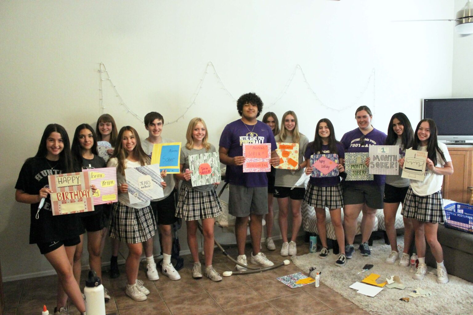 Image of high school students showing the signs they made for Maggie's Place