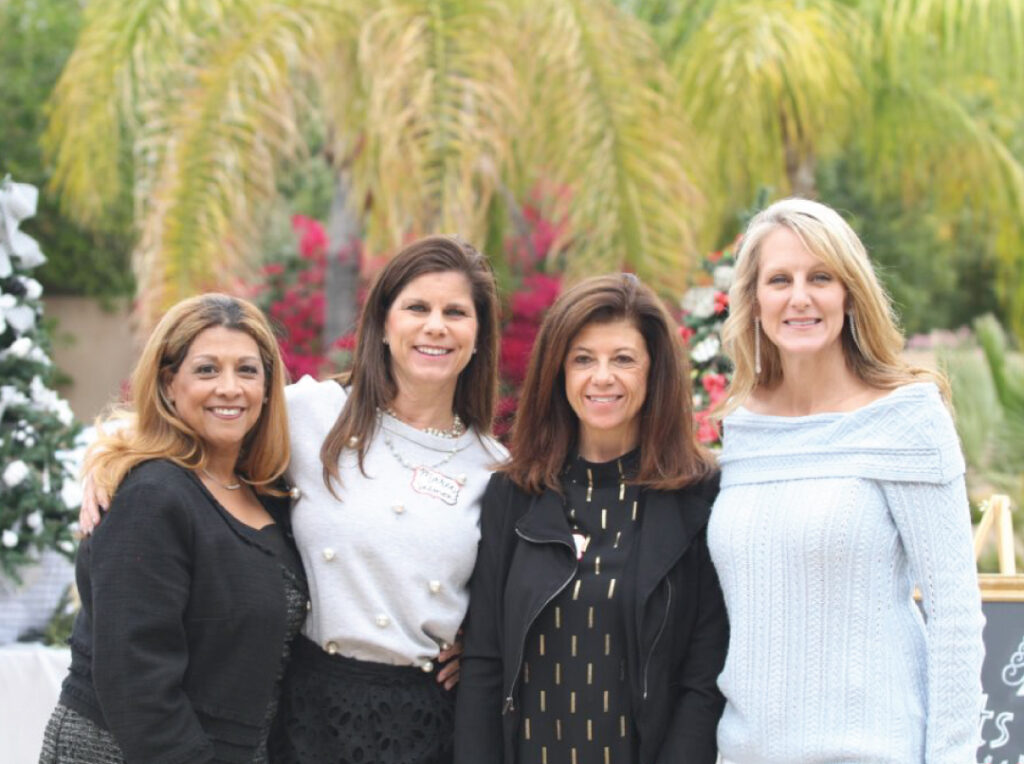 Image of four women smiling